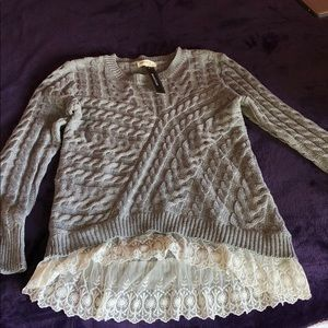 Knitted gray sweater with white lace trim detail